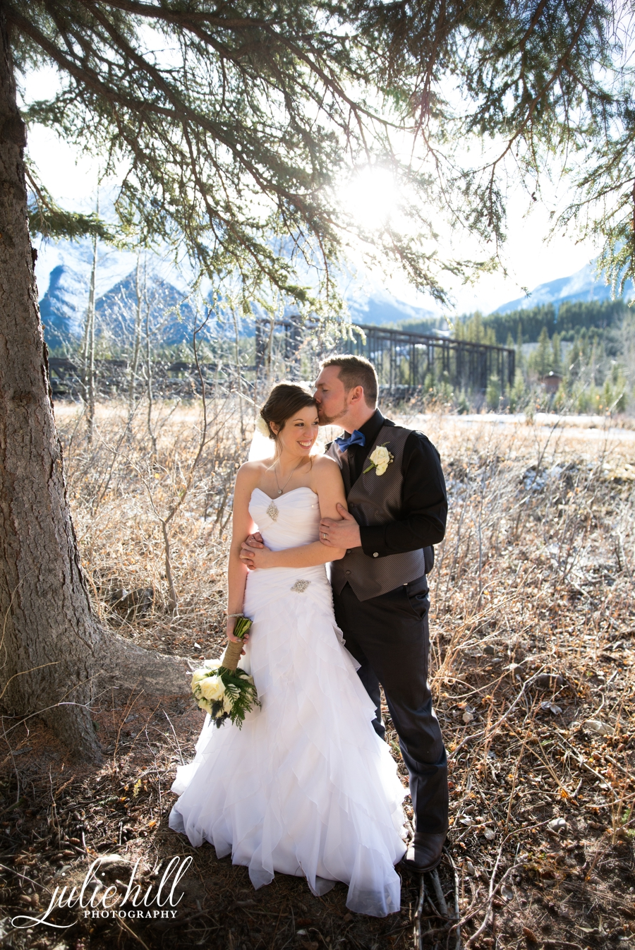 Julie-Hill-Photography-Canmore-Iron-Railway-Bridge-Romantic-Wedding-Winter-Canmore-Golf-Curling-Club-Sun-Flare-Photo